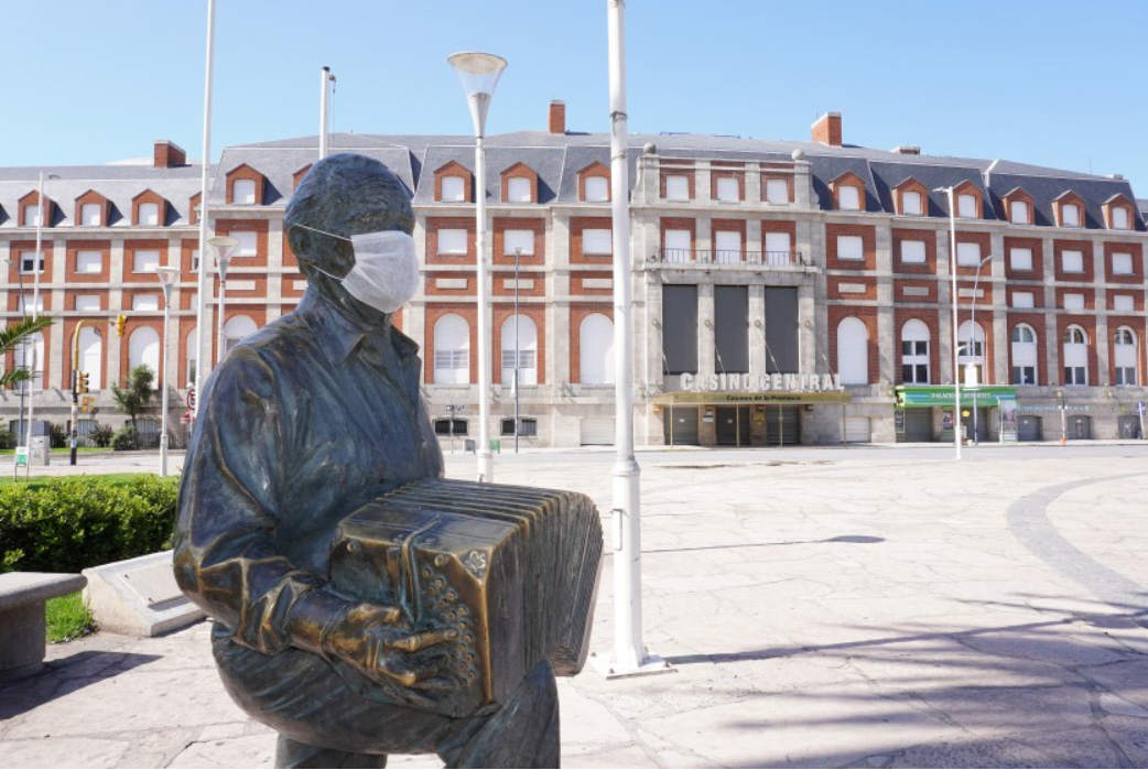 A statue of Astor Piazzolla, adorned with a face mask, stands on a pandemic-empty sidewalk near Buenos Aires' Central Casino in March 2020.(Getty Images)